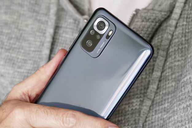 Xiaomi Redmi Note 10S being held in one hand.