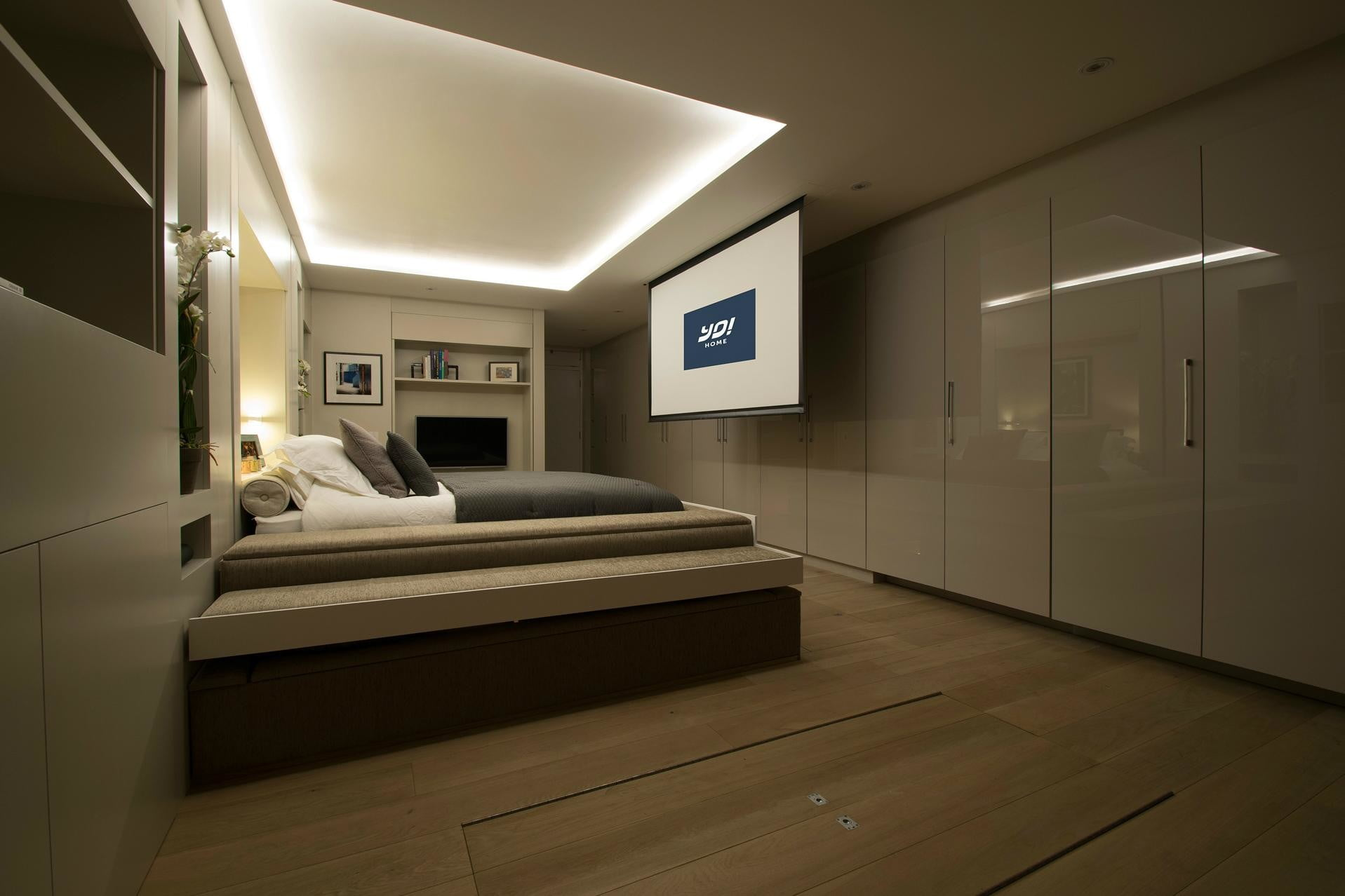 the yo home apartment has a bed that raises to ceiling transformable bedroom