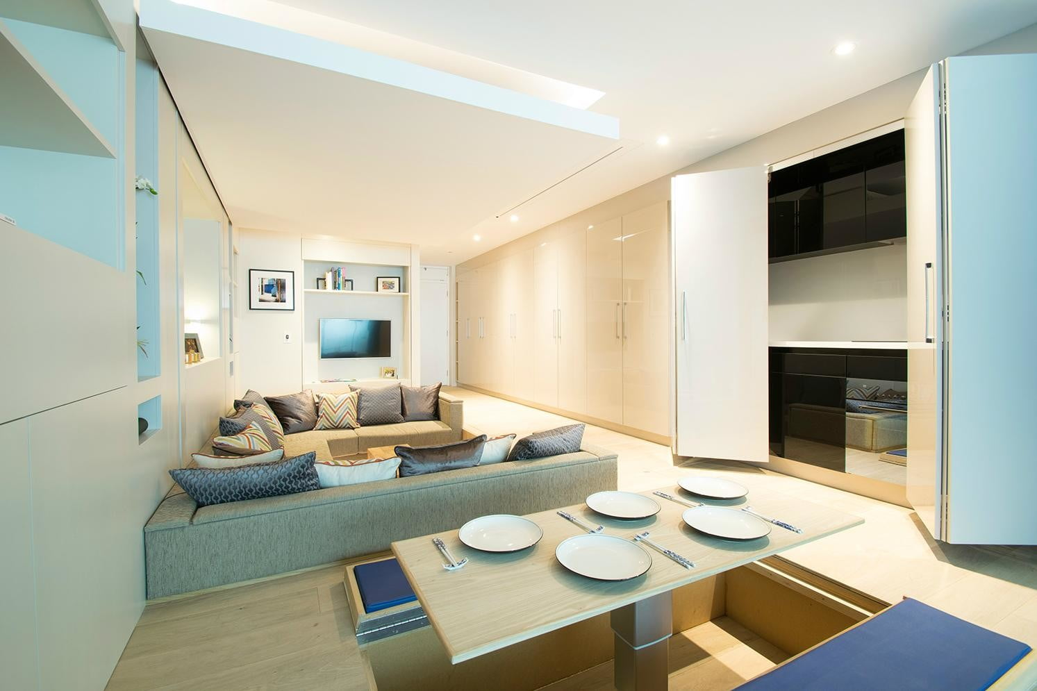 the yo home apartment has a bed that raises to ceiling transformable dining room
