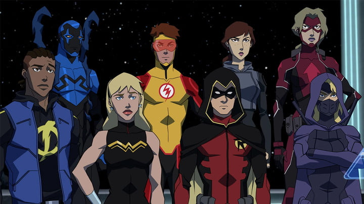 The superheroes of Young Justice stand as a group.